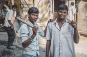 Young Indian workers stand — Stock Photo