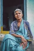Woman sits in sari in-front of home — Stock Photo