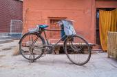 Newspaperman's bicycle on street — Stock Photo
