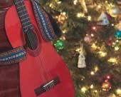 A Classical Guitar Beside a Christmas Tree — Stock Photo