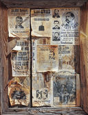 A Wooden Frame Full of Wanted Posters — Stock Photo