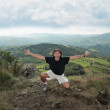 Man at the top of a mountain — Stock Photo #64008107