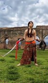 Oriental odalisque with sword — Stock Photo