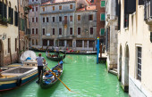 Canal in Venice with gondolas — Stock Photo