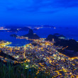 Night view of mountain Sugar Loaf and Botafogo in Rio de Janeiro — Stock Photo #65676209