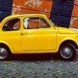 Yellow Fiat 500 in Rome. Italy — Stock Photo #75544771