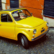 Yellow Fiat 500 in Rome. Italy — Stock Photo #75544775