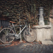 Bicycle parked near drinking tap on the street in Rome, Italy — Stock Photo #76769591