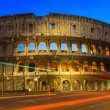 Night view of Colosseum with traffic lights in Rome, Italy — Stock Photo #76770043