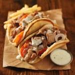 Greek gyros with tzatziki sauce — Stock Photo #54233583