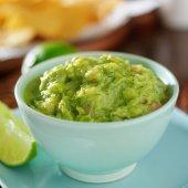 Guacamole in colorful blue bowl — Stock Photo