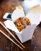 Chinese take out with smart phone — Stock Photo