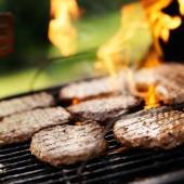 Hamburgers grilling — Stock Photo
