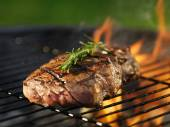 Steak with flames on grill — Stok fotoğraf