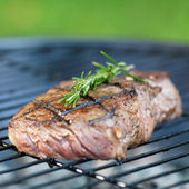 Steak with flames on grill — Stock Photo