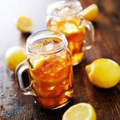 Sweet tea in a rustic jar — Stock Photo