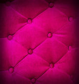 Buttoned on pink texture sofa repeat background. — Stock Photo