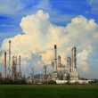 Petrochemical oil refinery with cloud and blue sky. — Stock Photo #58917023