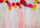 Colorful backdrop paper flower with fabric arrangement — Stock Photo
