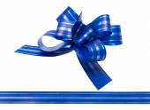 Shiny blue satin ribbon on white background — Stock Photo