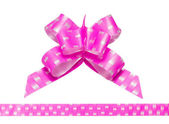 Shiny pink satin ribbon on white background — Stock Photo