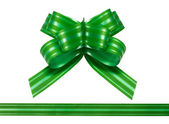 Shiny green satin ribbon on white background — Stock Photo