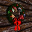 Christmas Wreath on Wooden Wall Background — Stock Photo #59115953