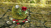 Heart Shaped Rock with Red and White Roses over a background with Rocks — Stock Photo