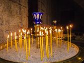 Burning Candles inside Stoned Chapel — Stock Photo