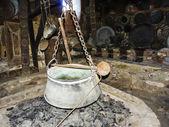 Old Iron Cauldron Pot and Spoon — Stock Photo