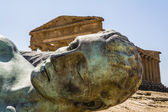 Concordia Temple behind the bronze Icarus sculpture - Valley of temples — Stock Photo