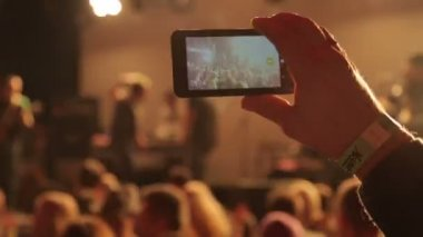 People taking video with touch smart phone during a music — Stock Video