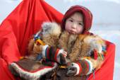 The little Nenets girl in national clothes — Stock Photo