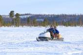 Two men go on a snowmobile — Stock Photo