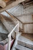 Wooden stairs in an abandoned house — Stock Photo