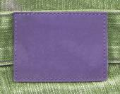Violet leather label — Stock Photo