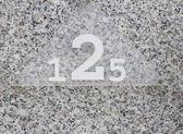 Door with numerals 125 — Stock Photo