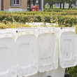 Row of large white wheelie bins — Stockfoto #62578295