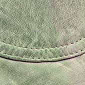 Fragment of pale green leather — Stock Photo