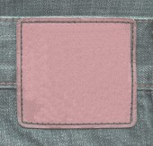 Reddish leather label on green jeans — Stock Photo