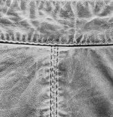 Fragment of gray leather coat — Stock Photo