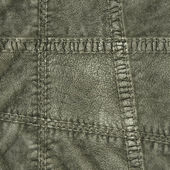 Fragment of green leather clothing — Stock Photo