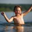 Adorable  baby girl splashing in a beautiful sea — Stock Photo #59459903