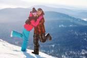 Happy snowboarding couple — Foto Stock