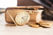 Golden pocket watch and law book — Stock Photo