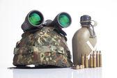 Military equipment with helmet and binoculars — Stock Photo