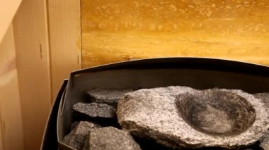 Sauna oven with hot stones — Stock Video