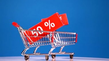 Moving shopping carts with sales icons — Stock Video