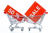 Shopping cart with sales icon — Stock Photo