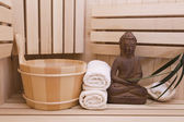 Ayurveda symbols for relaxation and inner beauty,buddha statue in sauna — Foto de Stock